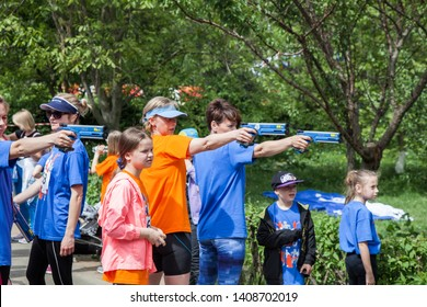 """Ukraine, Kyiv - May 18, 2019:   Open street competitions in running and shooting laser pistols - """"UIPM 2019 Global Lazer Run City Tour"""". Need to run and shoot laser pistols."""