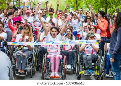 Ukraine, Kyiv,  — May 5, 2019: Beautiful brave girls.Wings for Life World Run - APP Run Kyiv. The charity run for the sake of those who cannot run. People with disabilities in wheelchairs and runners