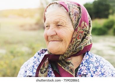 UKRAINE, LIPETSKOE - SEPTEMBER 06, 2017: Portrait of village-living elderly similling woman.