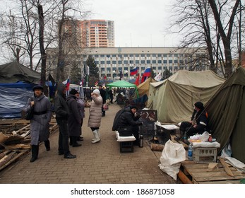 UKRAINE, LUGANSK - April 11, 2014: pro-Russian activists in camp park in front of the Ukrainian regional office of the Security Service in Lugansk