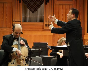 UKRAINE, LUGANSK - Feb 20, 2014: Lugansk Symphony Orchestra gave concert in memory of victims of armed clashes in Kiev. The conductor of orchestra was Sergey Chernyak, Soloist  - Taras Mentsynsky