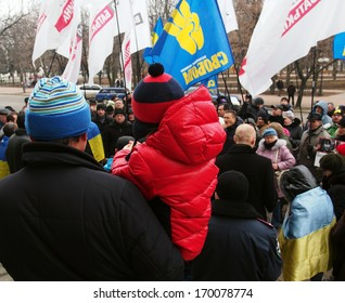 UKRAINE, LUGANSK - JANUARY 5, 2014: Opposition rally in Lugansk. Activist with a child involved in an opposition rally
