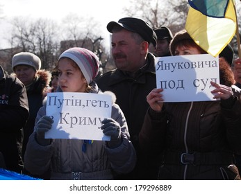 UKRAINE, LUGANSK - March 1, 2014: Euromaidan activists evaluate events in Crimea clearly this is occupation of country by Russia. They took banners demanding from Vladimir Putin to stop aggression.