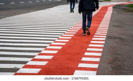 UKRAINE, LUTSK - May 10, 2020: Pedestrian walks on bike path.