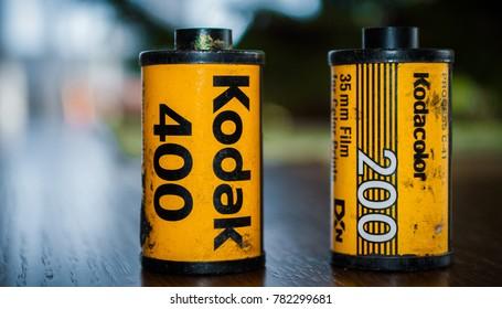 Ukraine, Lviv - January 26, 2017: Kodak film roll and Kodak film box on wood table and vintage background.