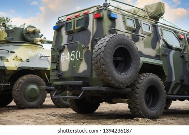 UKRAINE - MAY 9, 2019: Military armored personnel carrier and vehicle are on display  against the sky.