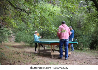 Ukraine, Nikolaev - 16 September 2018 people play table tennis in the forest. Outdoors sport
