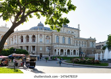 Ukraine, Odessa, 12th of June 2019. Side view of the national academic opera building and the park with fountain youth during a sunny day