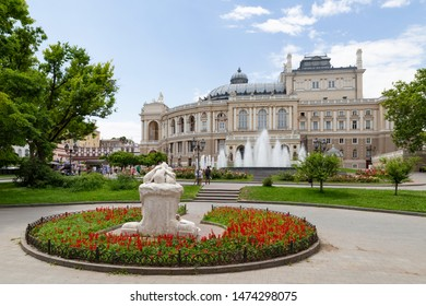 Ukraine, Odessa, 13th of June 2019. Side view of the national academic opera building and the park with the sculpture fountain youth during a sunny day