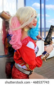UKRAINE, ODESSA - August 13, 2016: Cosplayer girl in Harley Quinn costume during Fan Expo Odessa, Comic Con