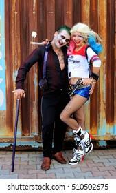 UKRAINE, ODESSA - August 13, 2016: Cosplayer girl in Harley Quinn costume and cosplayer men in Joker during Fan Expo Odessa, Comic Con