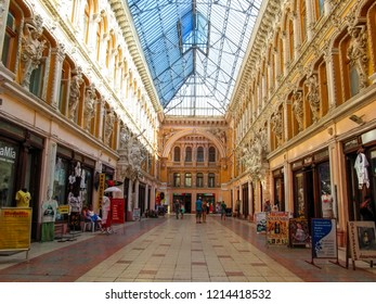 Ukraine, Odessa - June 08, 2015: Interior Gallery of Odessa 'Passage'. Numerous antique sculptures adorn the walls of the gallery with a blue glass roof