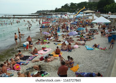 Ukraine, Odessa, June 2018:people on the beach are resting and swimming in the sea