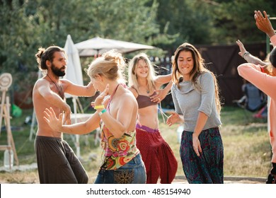 Ukraine, Odessa, Koblevo - august 26-29 - Handsome young poeople doing morning spiritual dance of happiness during Avatar yoga festival on august 26-29, 2016