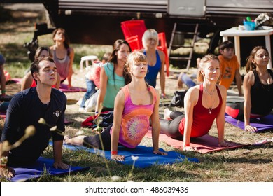 Ukraine, Odessa, Koblevo - august 26-29 - People during outdoor yoga class facing teacher at Avatar yoga festival on august 26-29, 2016