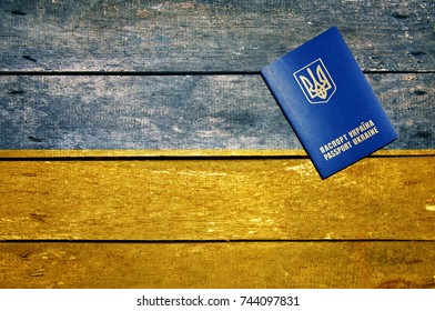 Ukraine passport on the table and flag