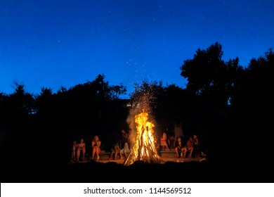 Ukraine, Priazovye - June 10, 2018: Bonfire at night with friends, family