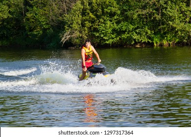 Ukraine, Sednev, the river Snov August 15, 2015: sports man riding a water bike, jet ski. Extreme sports, tourism, healthy lifestyle