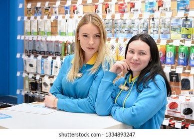 Ukraine, Shostka -March 8, 2019: Young sellers consultants stands behind the store counter