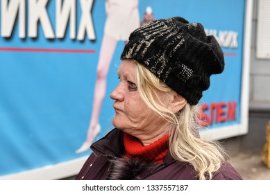 Ukraine, Shostka -March 8, 2019: Portrait of adult homeless poor woman in the street
