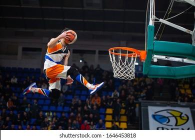 UKRAINE SUPERLEAGUE ALL STAR GAME, Match of the Stars - 2020, 01/02/2020, Palace of Sports, Kyiv, Ukraine. Barjots Dunker kicks the ball into basket, Jump high to the rihm. Slam dunk with trampoline