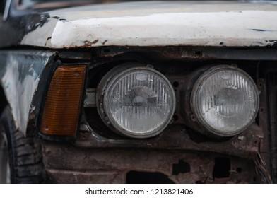 Ukraine, Ternopil - October 27, 2018:  View of a battered and broken retro BMW in Ukraine, Ternopil.