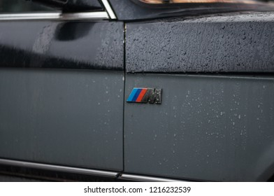 Ukraine, Ternopil - October 27, 2018:  View of a battered and broken retro BMW and logo M-power on a car in Ukraine, Ternopil.