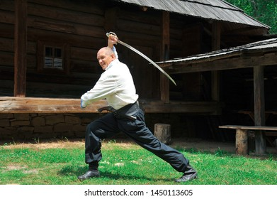 Ukraine. Ukrainian traditions. Carpathians. Ukrainian Cossacks. The elder is engaged in a saber in nature. Classes and master classes in kung fu, taiji, qigong, multidimensional medicine, healthy life