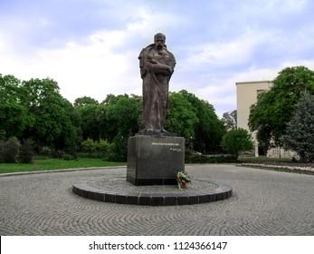 Ukraine, Uzhhorod - April 30, 2018: Monument of Taras Shevchenko at the Narodna Square in Uzhgorod. Bright landscape, stone-paved square and sculpture of the Ukrainian famous poet in full growth