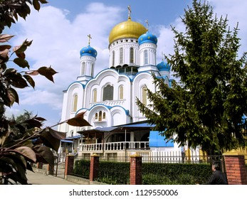 Ukraine, Uzhhorod - April 30, 2018: Amazing  Holy Cross Cathedral in the center of Uzhgorod. A delightful majestic Orthodox church with golden and blue domes, in Russian-Byzantine architectural style