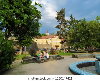 Ukraine, Uzhhorod - April 30, 2018: Heroes of Maidan Square in Uzhgorod. A modern well-groomed park with ancient buildings in the background in the spring-summer day