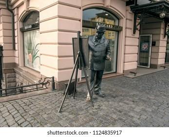 Ukraine, Uzhhorod - April 30,2018: Statue of painter Ignac Roskovics on embankment of Independence in Uzhgorod. The bronze artist, standing at the easel, paints the landscape, sculptor Mikhail Kolodko