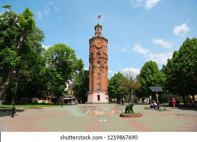 UKRAINE, VINNYTSIA, MAY 27, 2017: People near old water tower, old firedepartment, now the war veterans museum, in center of Vinnytsia - city in central Ukraine, located on banks of Southern Bug river