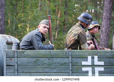 Ukraine, Voronezh - September 2, 2018: Reconstruction of the Second World War, german soldiers riding in the car in the forest.