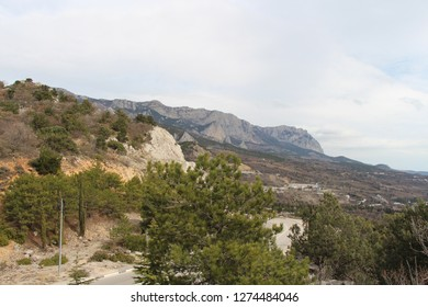 Ukraine, Yalta - March 08, 2013: View on valley and Mount Ai-Petri (from Greek: Saint Peter). Ai-Petri is one of the windiest places in Crimea. The peak is located above the city of Alupka.