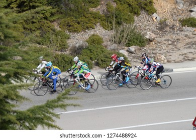 Ukraine, Yalta - March 08, 2013: View on cyclists on road between Yalta and Sevastopol.