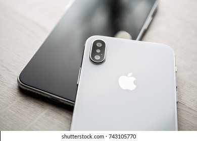 UKRAINE-17 SEPTEMBER,2018:Buy newest Iphone XS cellphone model.Modern mobile phone with touch screen&high quality dual camera lenses.Trendy Apple Iphone Ten S copy.Two cell phones on table in close up