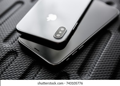 UKRAINE-17 SEPTEMBER,2018:Iphone XS new phone model closeup.Modern mobile Apple phones with touch screen,dual camera lenses.Tempered glass case,dual cameras on back panel.Luxury smartphones models