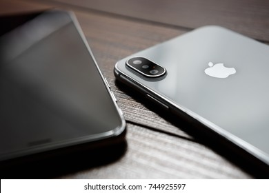 UKRAINE-17 SEPTEMBER,2018:Iphone XS smartphones in closeup.Latest Apple Iphone Ten S mobile phones.Mobile adget with big black touchscreen & high quality dual vertical cameras.New iphones on table