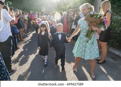 Ukraine.Kiev - September 1, 2016. First-graders and other students on the line near the school.