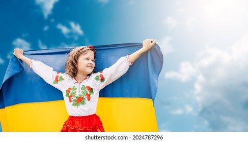 Ukraines Independence Flag Day. Constitution day. Ukrainian child girl in embroidered shirt vyshyvanka with yellow and blue flag of Ukraine in field. flag symbols of Ukraine. Kyiv, Kiev day