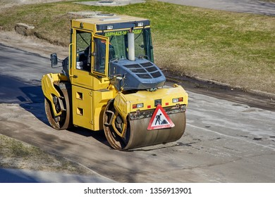 Ukraine,Shostka, Mira street -March 26, 2019 Construction work on an broken asphalt road