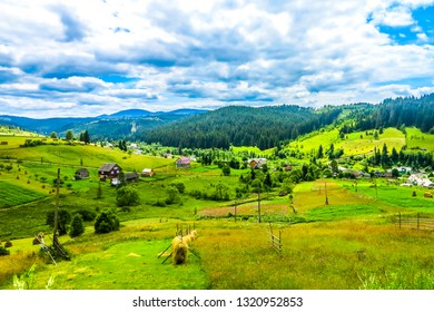 Ukrainian Carpathian Mountains Typical Common Village with Landscape View and Blue Sky White Clouds Background