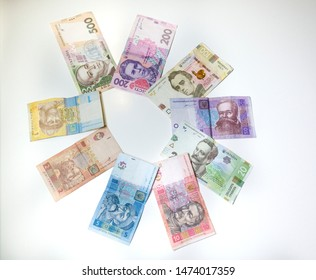 Ukrainian coins from a hryvnia made of round composition on a white background Buy a fantastic composition conceptual Ukrainian money shoot from wonderful up to 500 hryvnia.