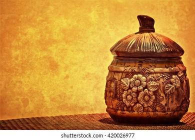 Ukrainian design pot on a yellow textured background