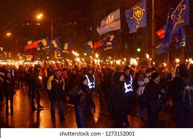 Ukrainian far-rightists marching through Kiev in a torchlight procession to celebrate the birthday of great Ukrainian nationalists leader Stepan Bandera. January 1, 2019. Kiev, Ukraine