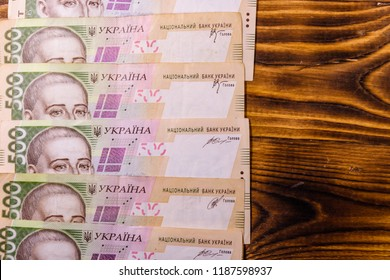 Ukrainian five hundred hryvnas banknotes on rustic wooden table. Top view