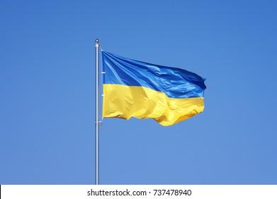 Ukrainian flag on blue sky backgroud