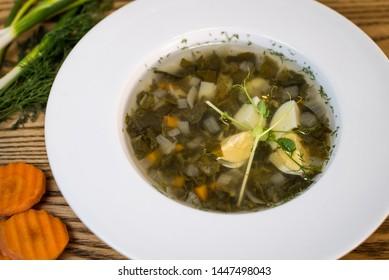 Ukrainian green borsch.Borsch with sorrel and nettles.Russian cuisine.Ukrainian cuisine