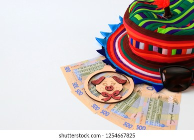 Ukrainian hryvna, banknotes 500 hryvnia, with pig 2019, colorful hat on white background, isolate. Christmas, New Year and travel  concept. Ukraine.